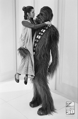 Peter Mayhew gives Carrie Fisher a lift in THE EMPIRE STRIKES BACK