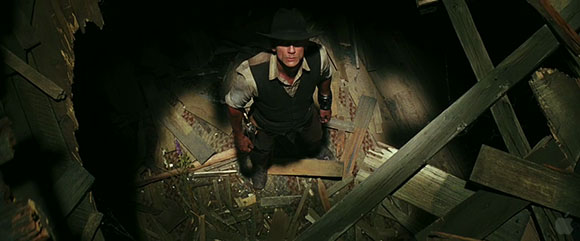 Daniel Craig investigates a mysterious attack from above in Jon Favreau's COWBOYS & ALIENS