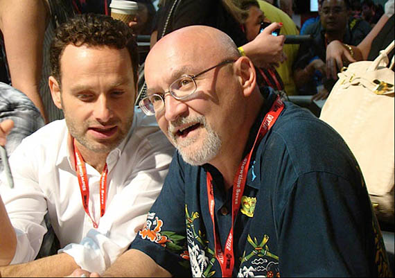 (L to R) Series star Andrew Lincoln (Rick Grimes) and THE WALKING DEAD writer, director and executive producer sign autographs at Comic-Con 2011. Photo c. and courtesy of AMC. All rights reserved.