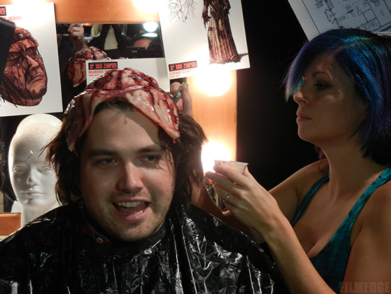 An open-minded volunteer tests a gory makeup appliance from Rob Zombie's House of 1000 Corpses maze at Universal's Halloween Horror Nights 2011
