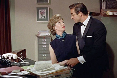 Lois Maxwell's Moneypenny flirts with Sean Connery's 007 per a Bond tradition past its time?
