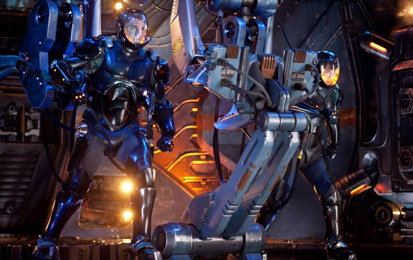 Jaeger pilots Raleigh Becket (Charlie Hunnam) and Mako Mori (Rinko Kikuchi) defend humanity against attacking kaiju monsters in Guillermo del Toro's PACIFIC RIM. c. 2013 Warner Bros/Legendary Pictures. All rights reserved.