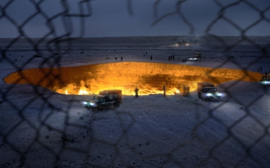 The 'Door to Hell' sinkhole in Turkmenistan as it appears under investigation by aerial M.U.T.O. research teams, all part of the viral marketing for Gareth Edwards' GODZILLA coming to theaters May 16, 2014. © Warner Brothers/Legendary Pictures.